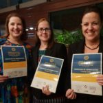 A photo of Belinda, Debra and Tarah with certificates 'Give a little change a lot""