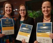 A photo of Belinda, Debra and Tarah with certificates 'Give a little change a lot