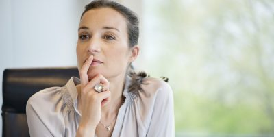 A photo a a woman thinking,. A close-up of a businesswoman thinking in an office
