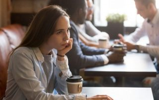 Photo of a female at the cafe, thinking