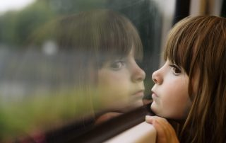 Photo of a girl looking out the window
