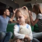 Domestic Violence Help in Queensland, Australia. Accompanying picture: A girl feels upset while parents fighting at background